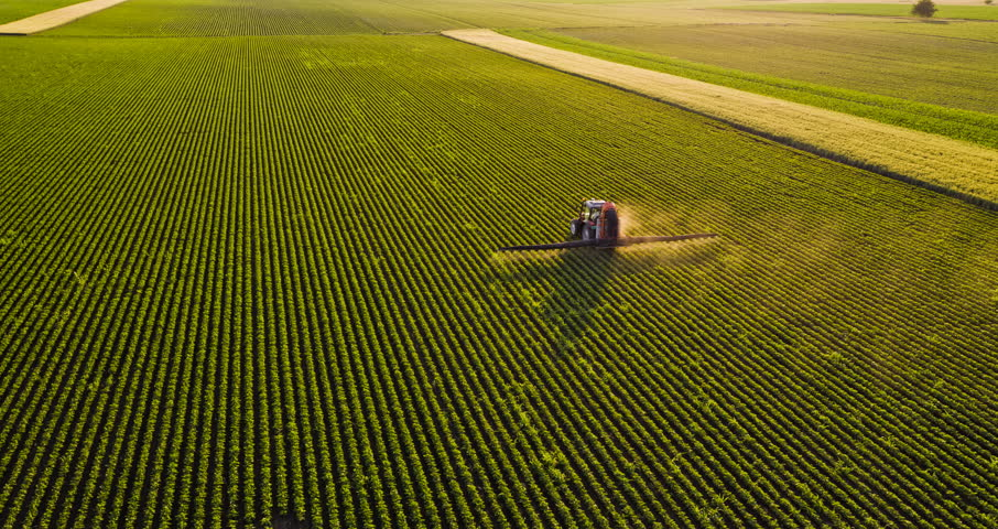 Aerial drone shot of a farmer spraying soybean fields | Shutterstock HD Video #27569626
