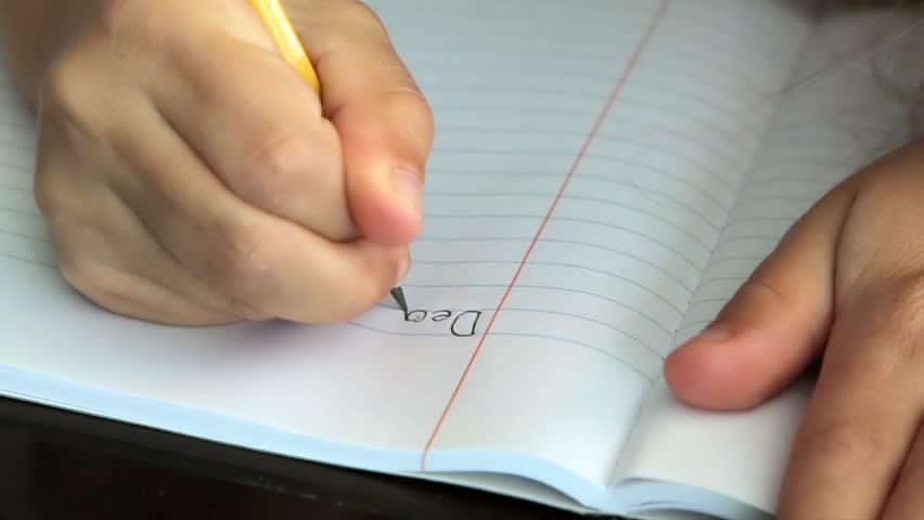 Child writing Dear Santa