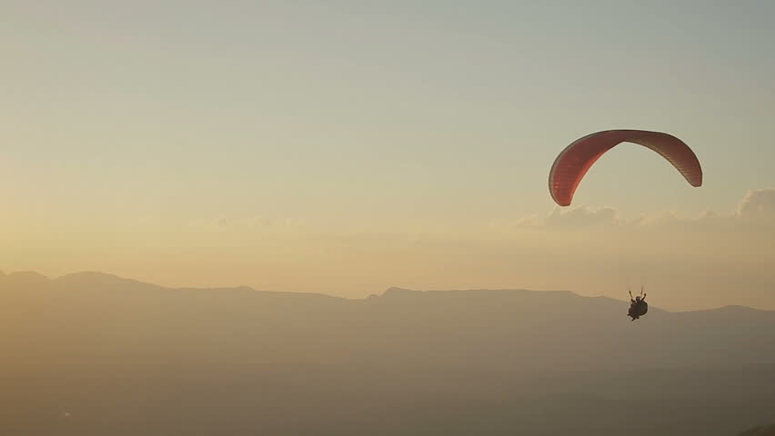Paragliding into the sunset in Brazil | Shutterstock HD Video #27609106