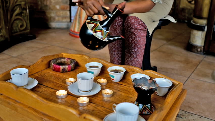 Ethiopian coffee ceremony: coffee is brewed three times (awel, kalei, baraka), host of ceremony is only a woman, coffee is pouring from jebena pot to finjal cups, burning incense is part of ceremony.