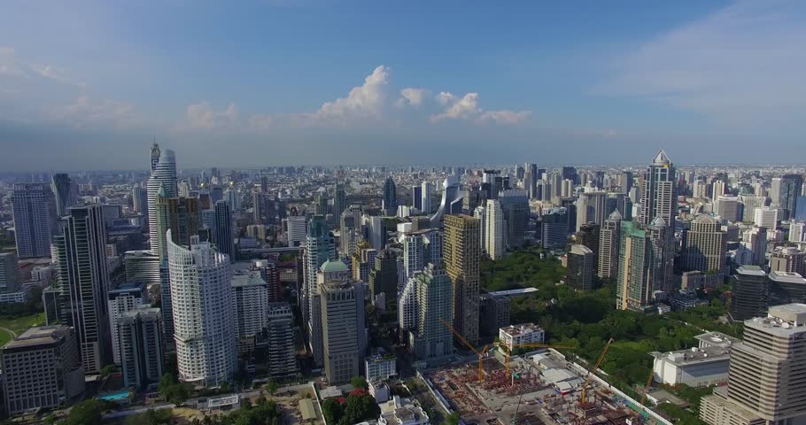 Aerial: Bangkok with a bird's eye view. Business center and traffic.