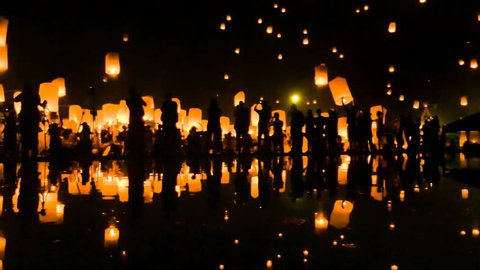 Many Sky Fire Lanterns Floating Up To The Sky In Yee Peng Lanna International 2016 And Reflection on Water Landmark Destination Travel Of Chiang Mai, Thailand