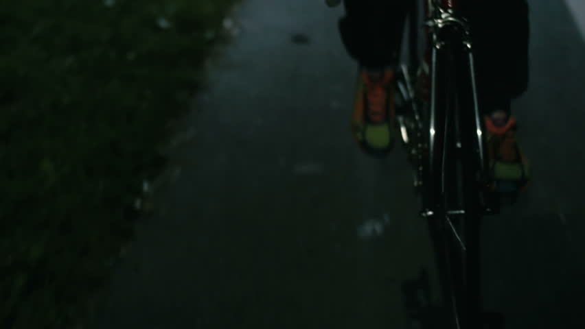 Cyclist riding a bicycle at night close-up