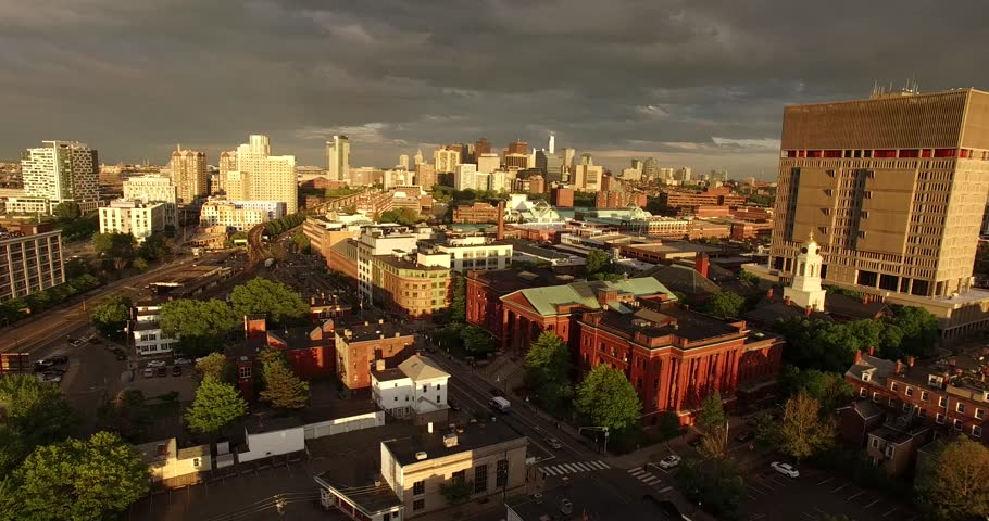 Epic aerial view of Cambridge and Boston Skyline during summer sunset