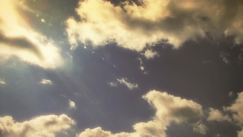 HD - Time lapse golden clouds travel across a sunsetting sky. | Shutterstock HD Video #2769476