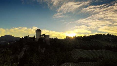 timelapse of sunlight behind castle in Brisighella in Emilia Romagna, Italy