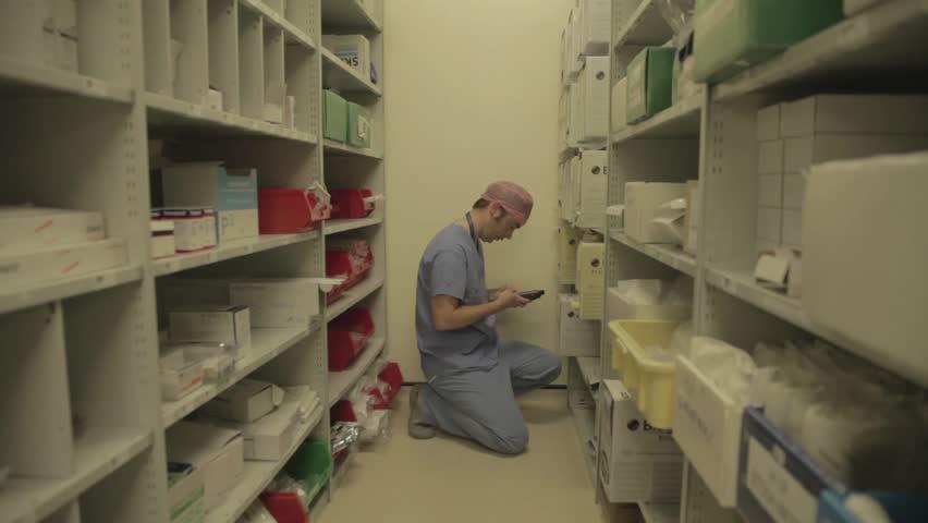 DERBY, UK, APRIL 2016 - Male nurses checking hospital supplies