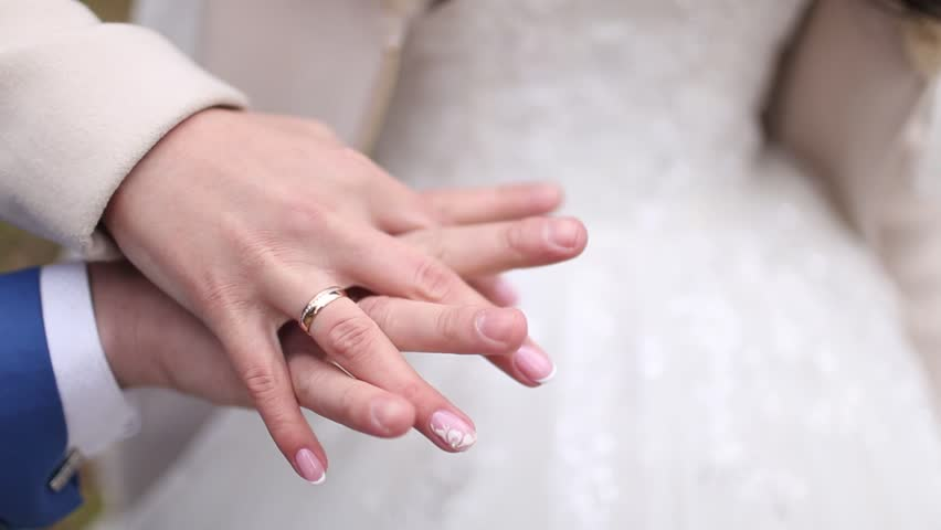 The Bride And Groom At Wedding Holding Hands Ring