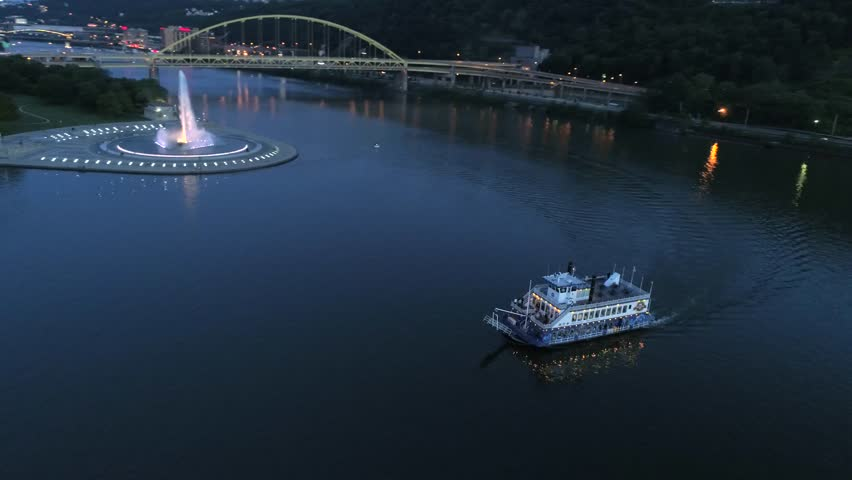 A wrap-around aerial of the fountain and boat ferry at Point State Park in Pittsburgh, Pennsylvania at night 4K | Shutterstock HD Video #27788986