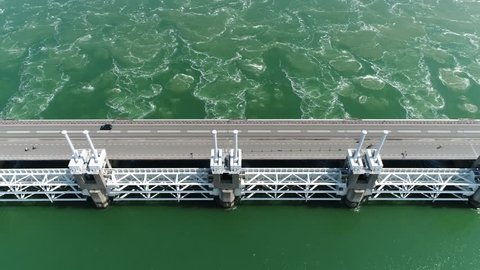 Aerial top-down view of Oosterscheldekering is the largest of the 13 ambitious Delta Works series of dams and storm surge barriers designed to protect the Netherlands from flooding from the North Sea