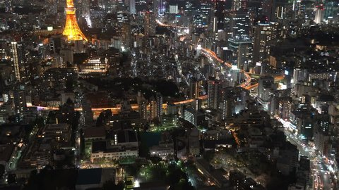 4k b-roll cinematic footage of night scene at Tokyo city with Tokyo Tower, aerial view. Tilt up
