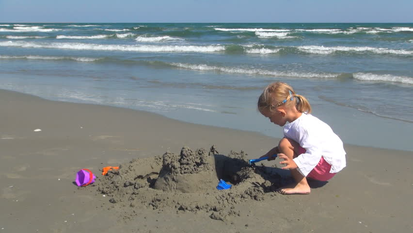 Child Playing on the Beach, Little Girl Having Fun with a Sand Castle