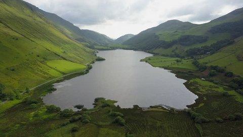 4K drone footage flyover Tal-y-lynn Lake, Snowdonia National Park, Wales