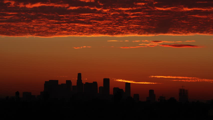 Time Lapse of the sun rising from behind downtown Los Angeles.