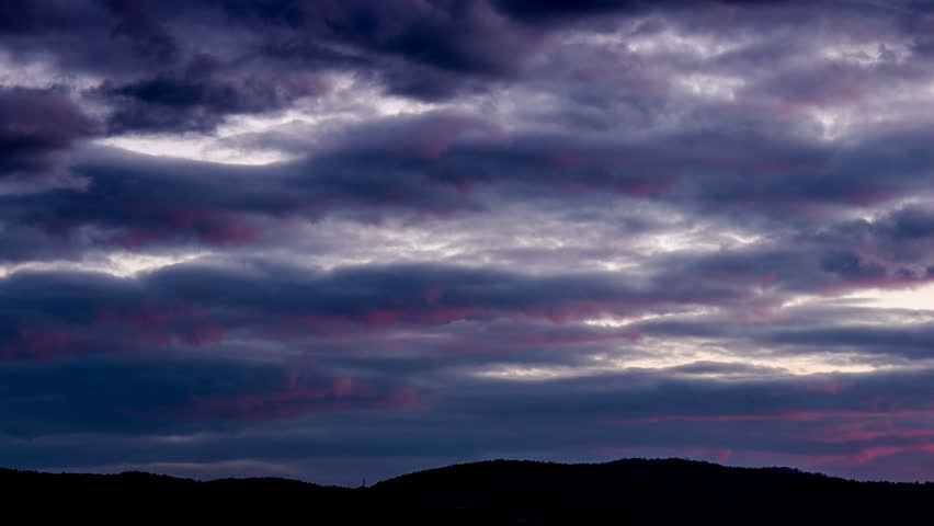 Dark sky storm clouds. Dramatic stormy weather background. Cloudy overcast nature scene. Gray purple cloudscape timelapse. Danger black thunderstorm time lapse. Ominous moody heaven cliemate landscape