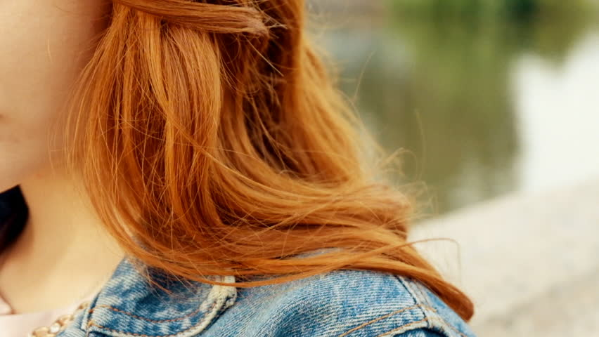 Grainy old film shot of ginger haired woman weared blue leans jacket closeup | Shutterstock HD Video #27917656