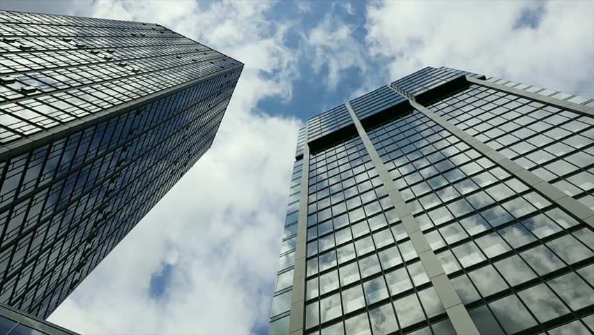 Time lapse of clouds over corporate buildings #27924016