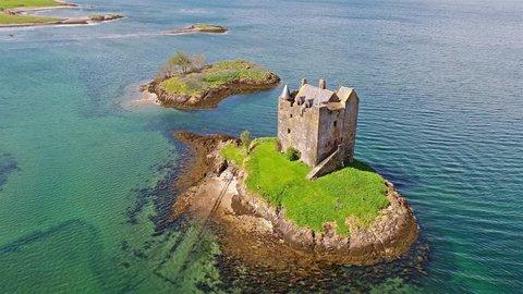 Aerial shot of medieval Castle Stalker on the west coast of Scotland between Fort William and Oban.