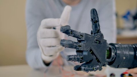Precise moves of bionic arm repeating moves of a real arm. 4K.