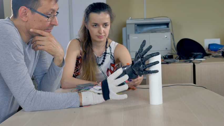 A woman holding bionic arm grabbing paper towels. | Shutterstock HD Video #27942646