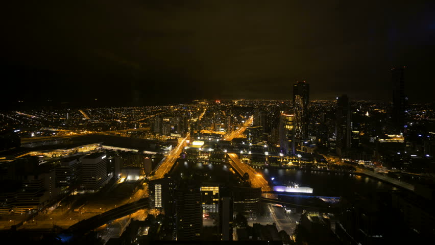 Time lapse Night scene at Melbourne CBD with motion blur traffic light trail. Zoom in | Shutterstock HD Video #27960406
