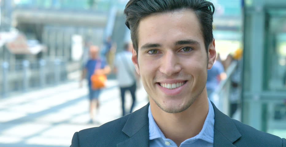Portrait of a young handsome businessman (student) in a suit, smiling, successful happy, at the station, at the airport. Concept: new business, travel the world, communication, contacts, business deal | Shutterstock HD Video #27992116
