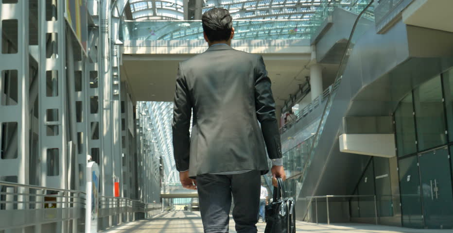 A young handsome businessman (student) in a suit, comes with a briefcase, at the station, at the airport. Concept: a new business, traveling the world, communication, contacts, a new deal, success.  | Shutterstock HD Video #27992323