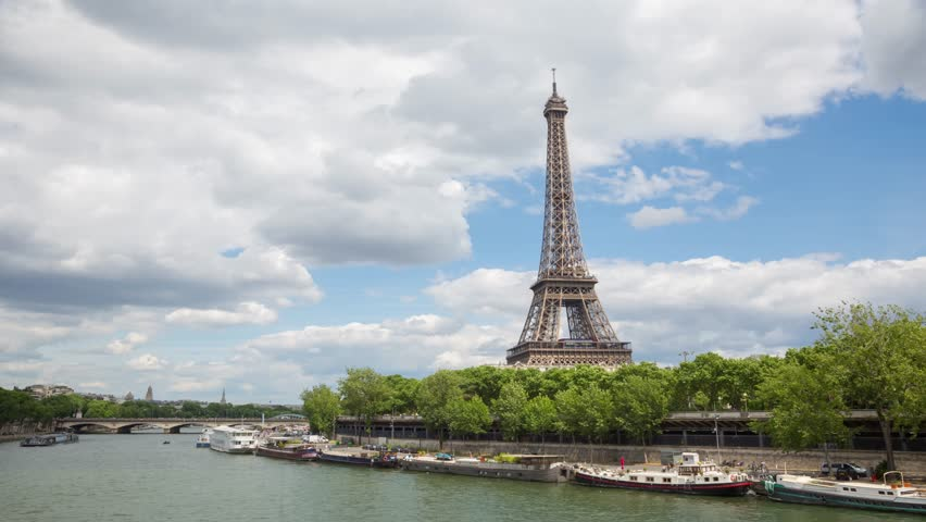 A timelapse of the Eiffel Tower and Pont d'I na along the river Seine with flyboats. Timelapse, 4K. | Shutterstock HD Video #28011706
