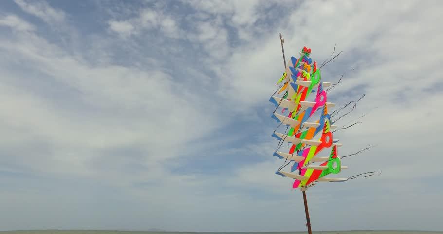 Molding of sailplane on the beach and cloudscape. Bang Saen Beach, Thailand.