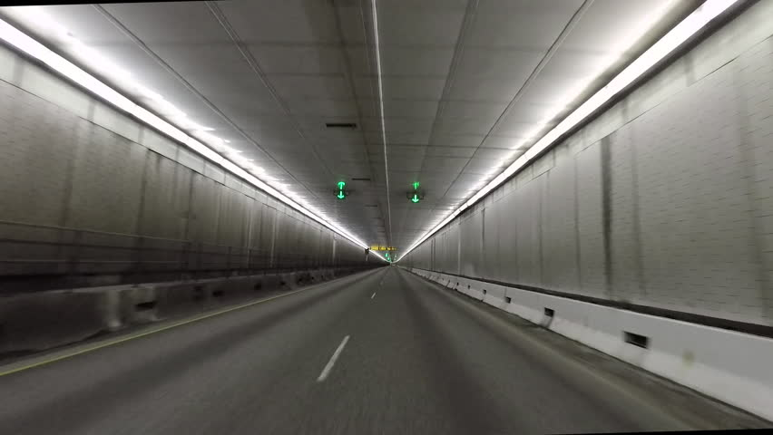 DILLON, COLORADO - 1 JUN 2017: Colorado Eisenhower Tunnel inside drive POV. Tunnel on I-70 crosses under continental divide in Rocky Mountains of Colorado. Dual four lane interstate. Point of view.