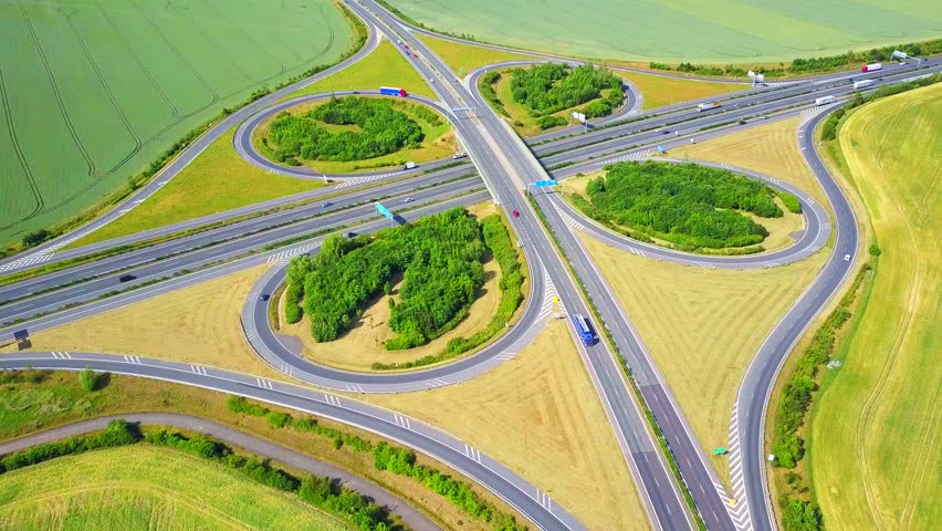 Aerial view of highway crossroad junction. D5 highway in west Bohemia, Czech republic, European union. Drone flight over road infrastructure in shape or pattern resembling a leaf of clover.