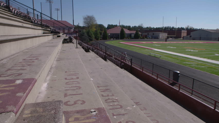 Empty student section of a high school football stadium