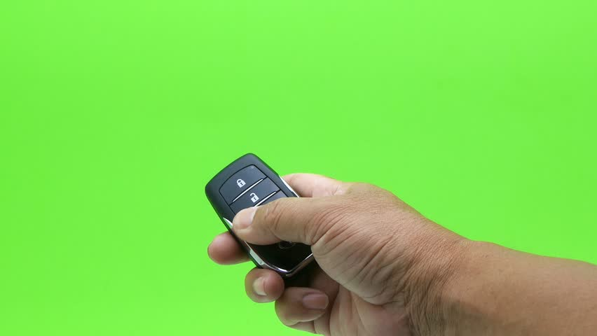 Hand presses car keys on green screen  | Shutterstock HD Video #28082656