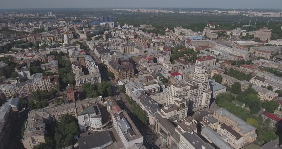 Kyiv city city landscape. City landscape from a bird's eye view. Urban infastructure from the top. Flight over the city. Summer, sunny day. Cars, people walk on the sidewalk, the architecture.   | Shutterstock HD Video #28099006