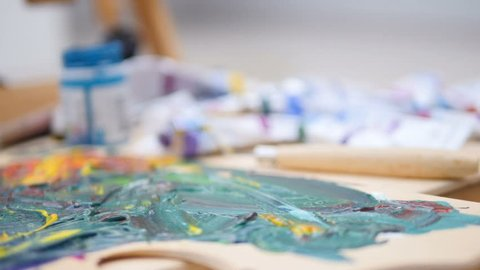 Paints and mixed colors left by an artist.