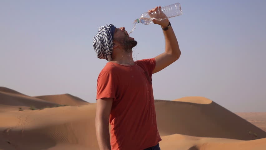 Image result for man drinking water in desert