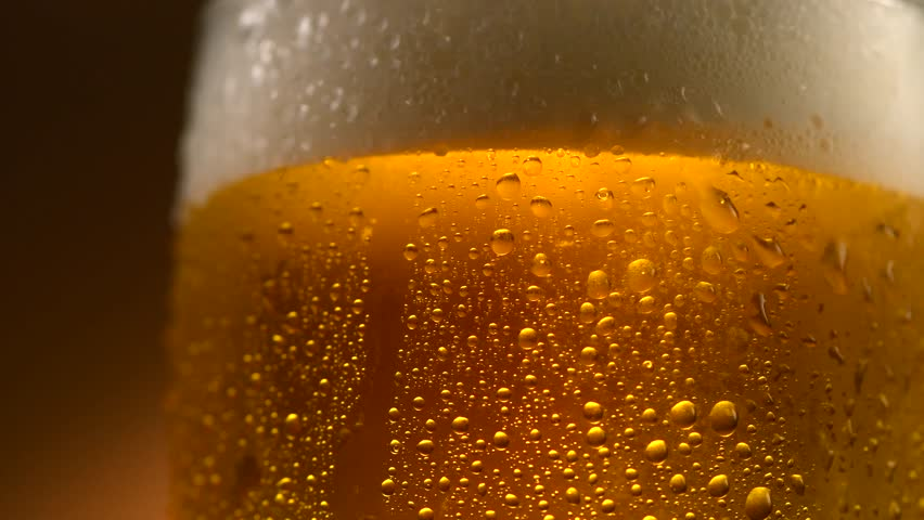 Cold Light Beer in a glass with water drops. Craft Beer close up. Rotation 360 degrees. 4K UHD video 3840x2160 #28149076