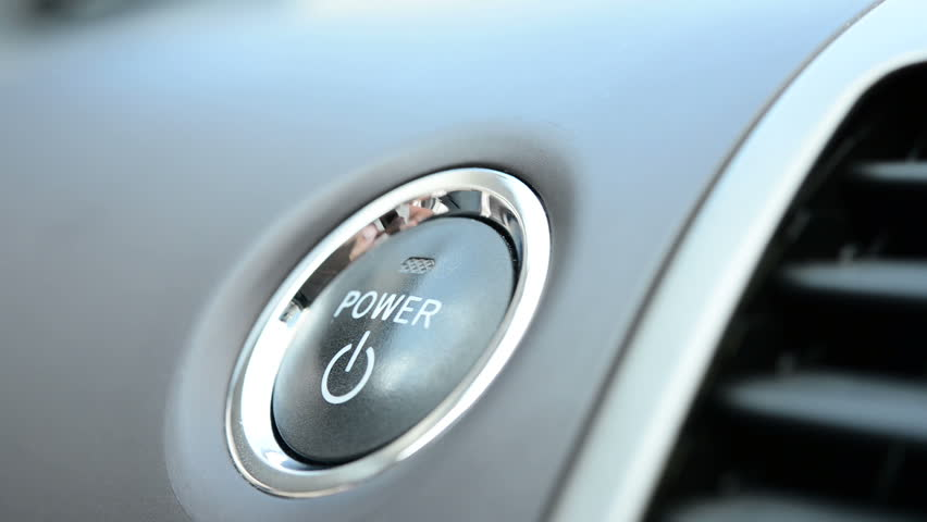 Pushing a power button in modern hybrid car
