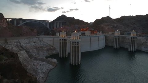 Hoover dam. Hoover dam and Lake Mead in Las Vegas area. Large Comstock Intake Towers At Hoover Dam. The Hoover Dam in the evening with illuminations without people.