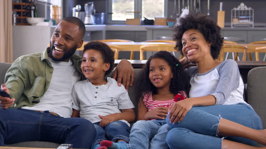 Family Sitting On Sofa In Open Plan Lounge Watching Television | Shutterstock HD Video #28165366