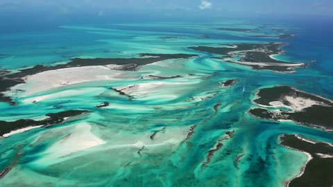 Exumas Bahamas Island Chain, beautiful afternoon AERIALS of colorful water and sand patterns view North at 2000 feet.