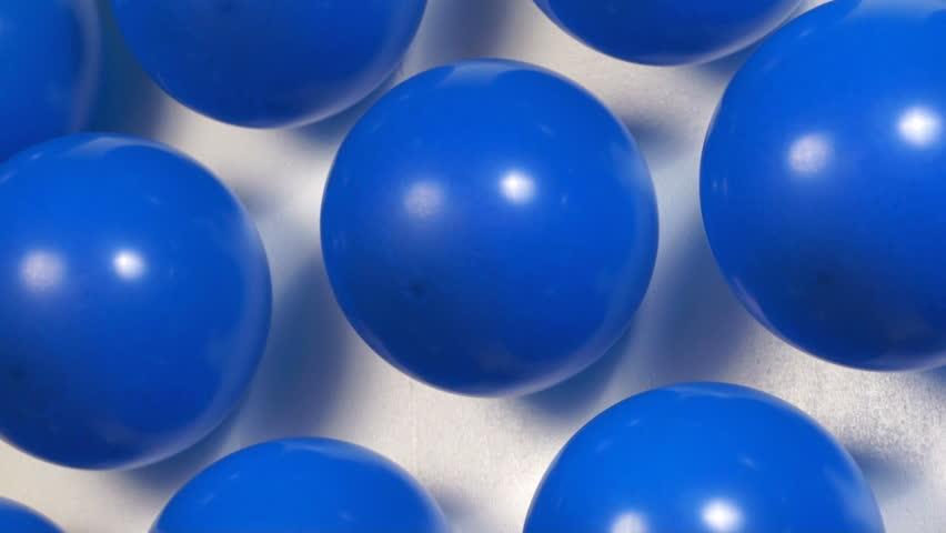 Blue balloons popping at carnival