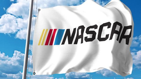 Waving flag with NASCAR logo. 4K editorial clip