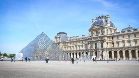 PARIS, FRANCE - MAY 23, 2017: Pyramids And The Building Of Louvre Museum In Paris