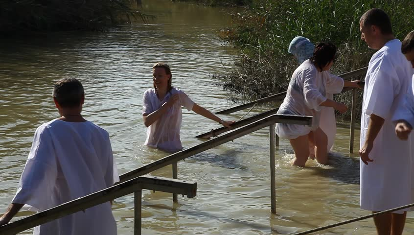 QASR AL YAHUD, ISRAEL – JANUARY 18: Greek Orthodox pilgrims baptize during the Epiphany at Qasr Al Yahud, Israel, January 18 2012