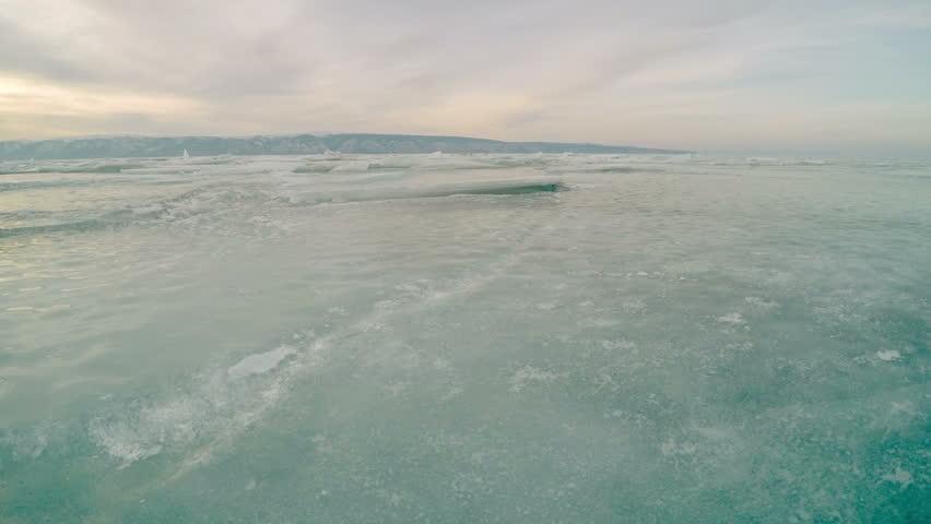 4K. Sunset in the icy Lake Baikal, Irkutsk region, Russia. Ultra HD, 3840x2160