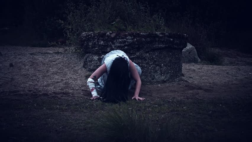 4k Horror Woman in Dirty Dress Next to a Well   Shutterstock HD Video #28307836