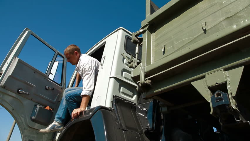 Driver Leaving Cab of Dump Truck