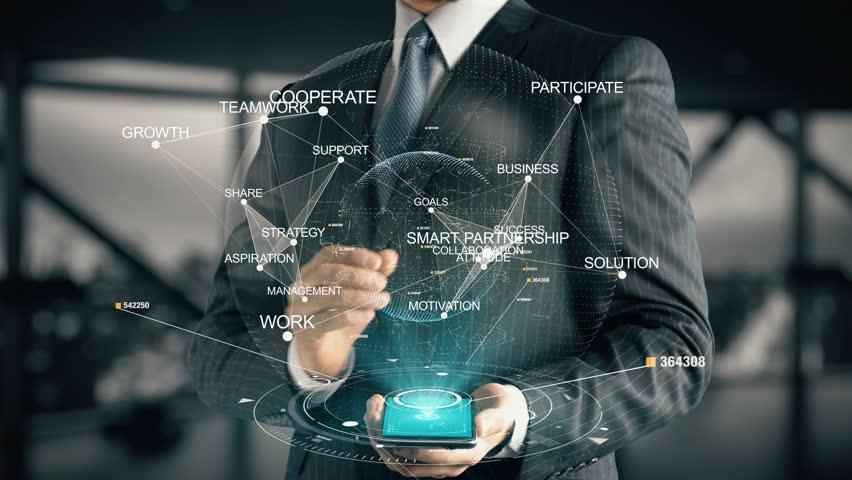 Businessman with Smart Partnership hologram concept | Shutterstock HD Video #28335952