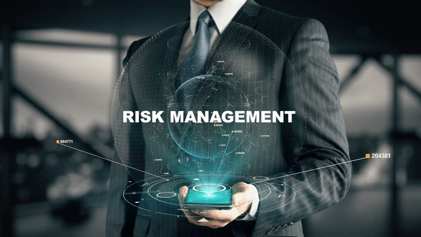Businessman with Risk Management hologram concept